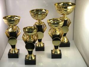 A collection of gold cup trophies.