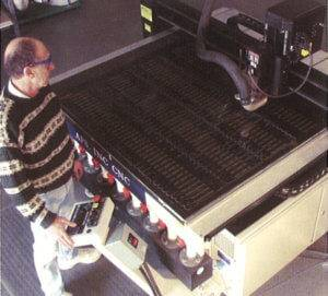 APS owner and founder, Dave Fertig, operates machinery to create personalized signage.