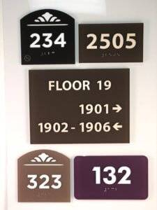 Examples of colored acrylic signage at APS.