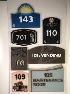 An assortment of different digitally printed signs created by APS.