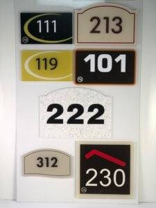 Examples of different styles of exterior signage available at APS.