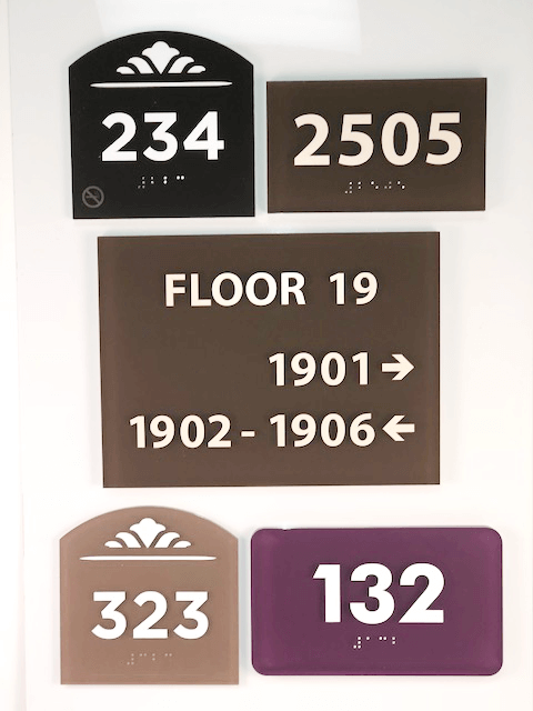 Colored acrylic signage examples created by APS.