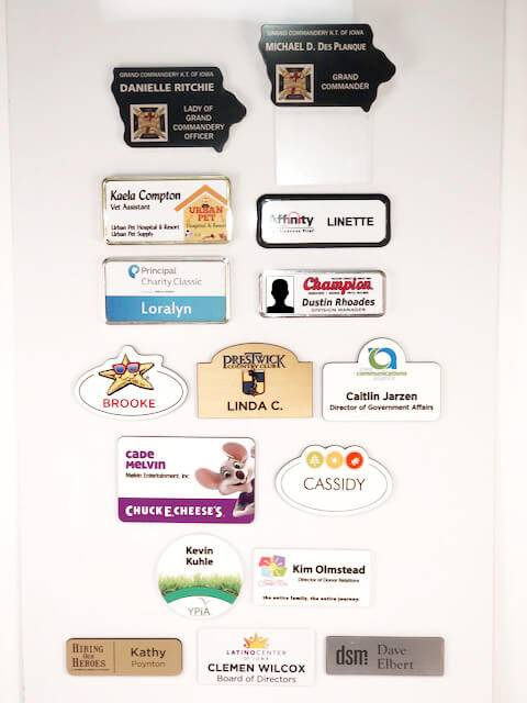 Examples of different types of name badges offered by APS Awards.