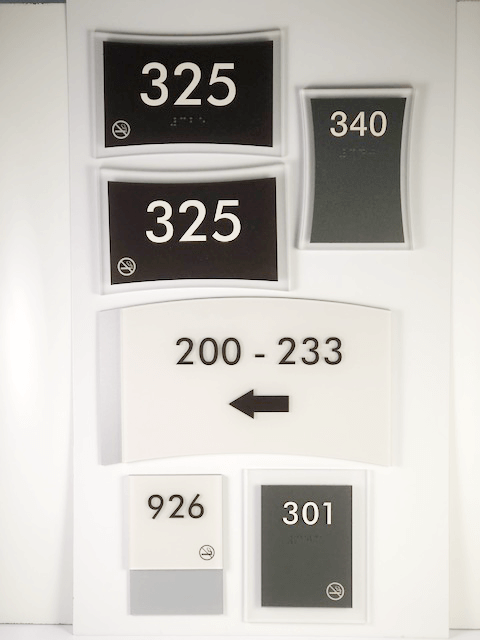 An assortment of layered-type signage available from APS.