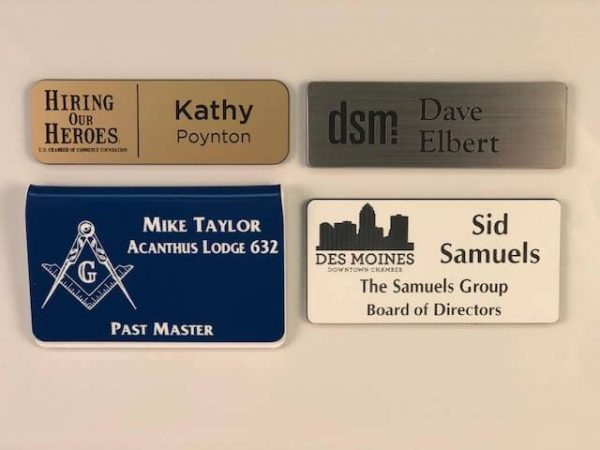 Different styles of engraved plastic name badges.