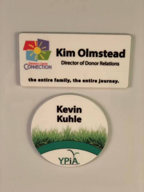 Two name badge examples of options available at APS.