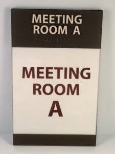 """Hotel room signage that says """"Meeting Room A"""""""