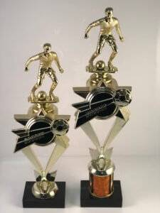 Soccer trophies with soccer players in a ready stance on top.