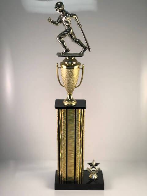 A trophy with a baseball player running on the top.