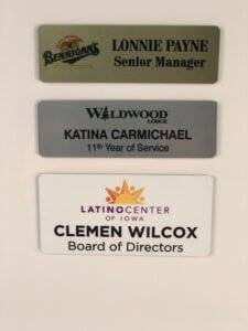 Examples of metal name badge options from APS Awards.